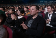Photo of Elon Musk Sitting Next to Ikumi Nakamura: A Review